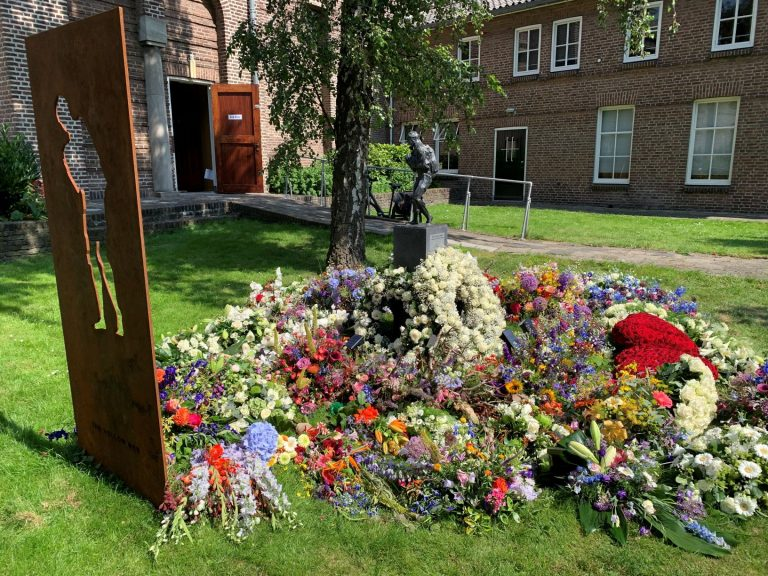 The Netherlands: Flowers of Murdered Journalist Placed Around Monument Fallen Refugees